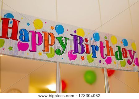 Inscription happy birthday with colored letters on a white background