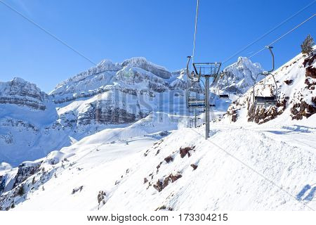 Empty Chairlift In The Mountains In A Sunny Day In Candanchu, Spain