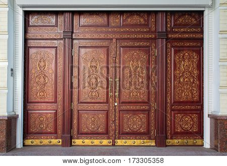 Luxury carved door in oriental style. Architecture