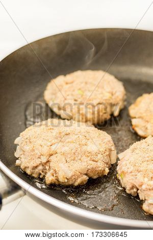 Frying Meatballs Of Minced Meat With Onions In The Frying Pan