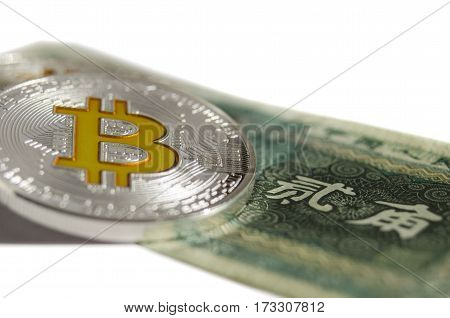 Shiny Silver Gold Bitcoin Coin Laying On Old Chinese Bill