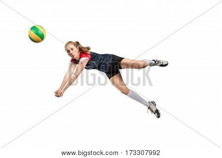 Female volleyball player jumping for the hard ball isolated on white background