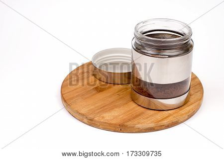 Glass Jar With Grated Coffee Over White Background