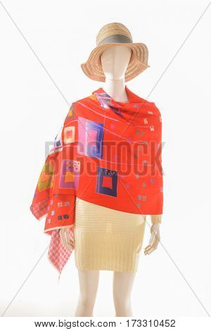 female clothing with hat and scarf on mannequin