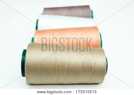 Spools Of Thread Various Color On A White Background