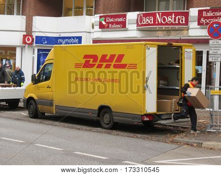 HAMBURG GERMANY - CIRCA NOVEMBER 2016: DHL Deutsche post van parked in a street of the city centre for delivery. DHL is one of the leading private mail companies in Europe.