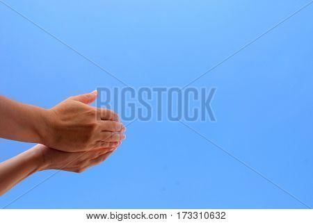 Hands of hopefull asking for forgiveness from god.