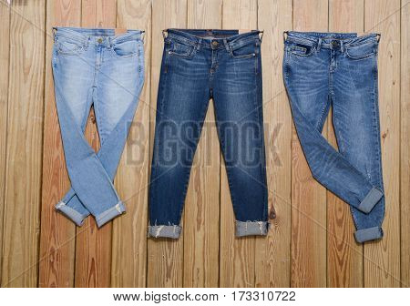 Three blue Jeans and wooden board