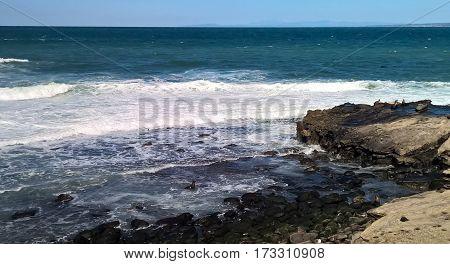 Beautiful crashing waves along La Jolla Cove.