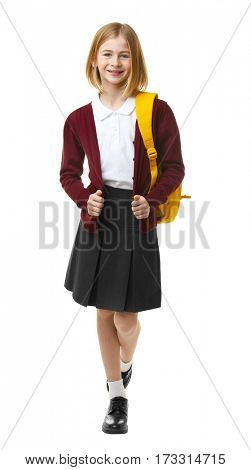 Cute girl in school uniform with backpack on white background