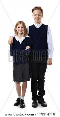 Cute girl and boy in school uniform on white background