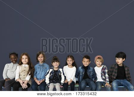 Happy Diverse group of kids sitting together