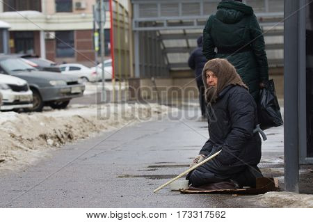 Kazan, Russia, 17 february 2017: Old woman Kazan, Russia, 17 february 2017: Woman beggars asked money on street, poor disable people horizontal