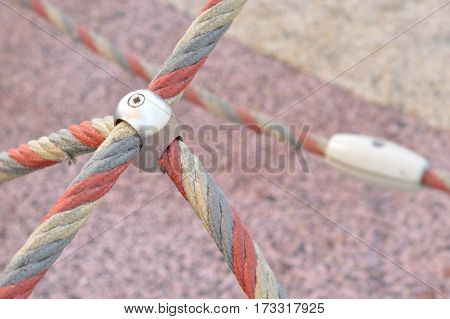 Iron jointed point of ropes in children spider web with copy space for text.