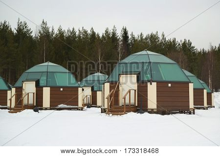 SINETTA, FINLAND - FEBRUARY 16, 2017: Glass Igloos at Arctic Snow Hotel in Finnish Lapland. Arctic SnowHotel is located on the Arctic Circle in Finnish Lapland.