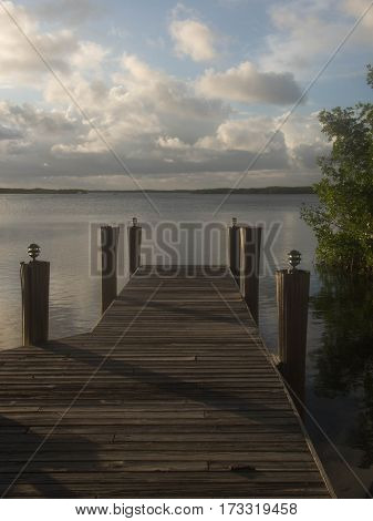 Hazy Wooden Dock at Twilight in Sunny Key West Florida
