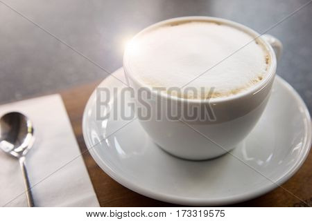cup of cappucino coffee on the table