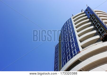 Modern apartment building with balconies apartments building residential condo balconies structure urban facade on blue sky
