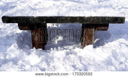Snow And Wooden Bench In The Walkway Forest Winter