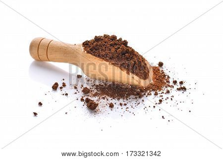 coffee powder in wooden scoop isolated on white background