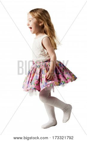 Cute three-year girl is jumping, running, dancing, laughing. Her hair is not combed. Isolated on white background.