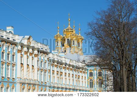 Domes of Church of the Resurrection of Catherine Palace against the background of the blue sky in the April sunny day. Tsarskoye Selo, St. Petersburg