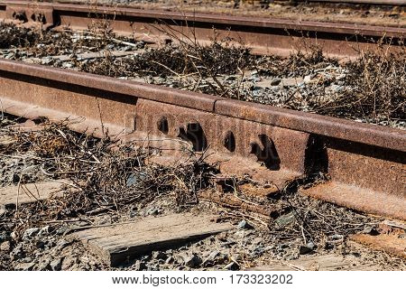 Close-up view of steel rails and wooden ties on railroad tracks.
