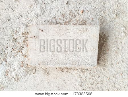 Wood label on rough concrete background.White minimal