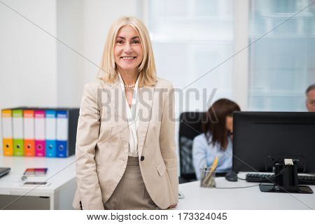 Portrait of a smiling businesswoman in her office