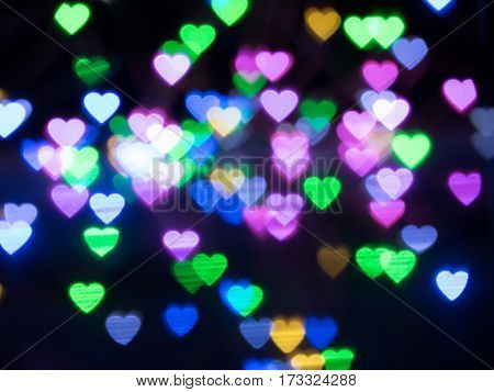 abstract colorful heart shape light bokeh background