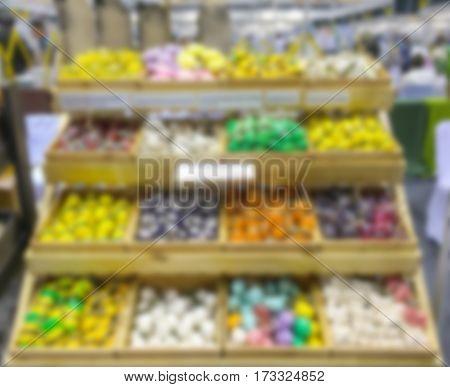 supermarket shelves in blur for background .
