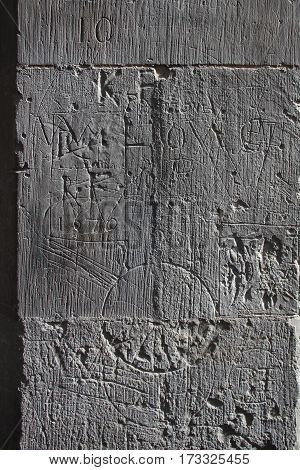 Medieval graffiti (1676) scratched into the stone wall of an English Cathedral (St. Albans)