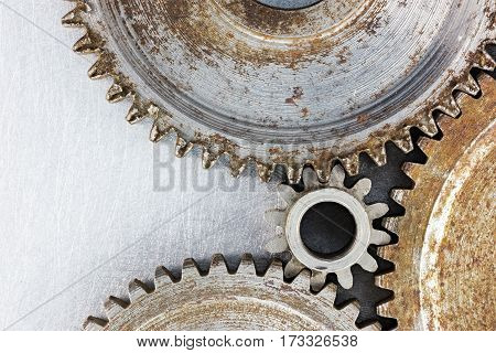 Old Worn Out Rusty Cogwheels On Industrial Background