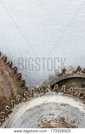 Rusty Metal Cogwheels On Scratched Industrial Background Macro