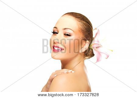 Beautiful laughing spa woman with lily.