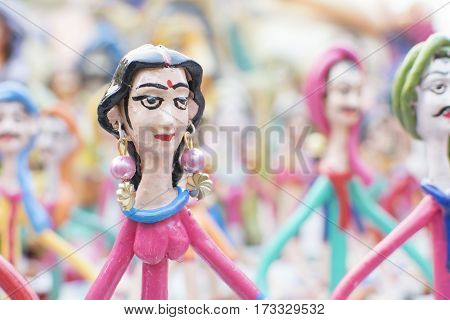 Colorful dolls made of clay handicrafts on display during the Handicraft Fair in Kolkata earlier Calcutta West Bengal India. It is the biggest handicrafts fair in Asia.