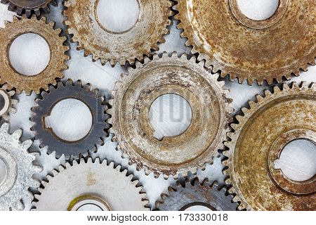 set of various metal used industrial gearwheels with rust in high resolution top view