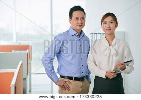 Portrait of smiling Asian business team in office