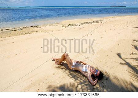 Young Woman In Bikini Lying On The Beach On Makaha'a Island Near Tongatapu Island In Tonga