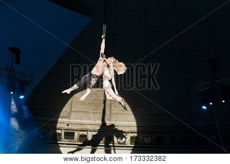 Stunt aerialists men and women in the circus. Love, danger, and romance concept.