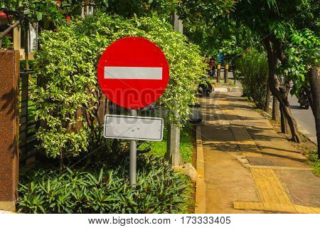 Forbidden sign board with red colour and horizontal white line in the middle photo taken in Jakarta Indonesia java