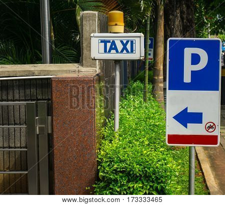 Parking and taxi sign board at gate of Central Park Mall photo taken in Jakarta Indonesia java