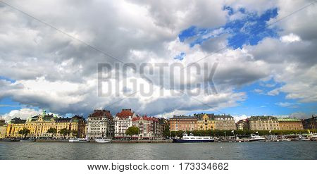 View on Strandvagen street on Ostermalm distric with touristic sightseeing boats in Stockholm Sweden