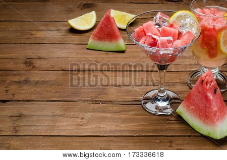 Juicy Slices Of Watermelon, A Glass Of Watermelon Slices, Close-up On A Brown Wooden Table, Space Fo