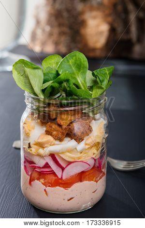 Glass jar with fresh salad