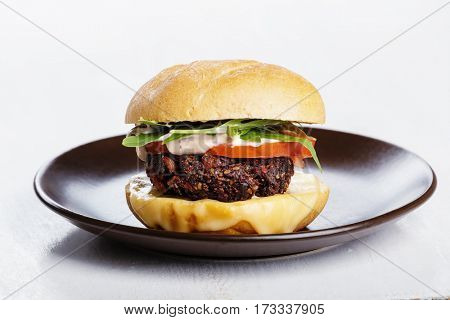 Vegetarian burger with cheese and vegetables