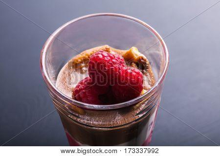 Glass of chocolate and rapsberry dessert