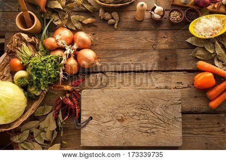Empty wooden board for cutting vegetables and preparing food. Free space for text of menu for vegetarians.