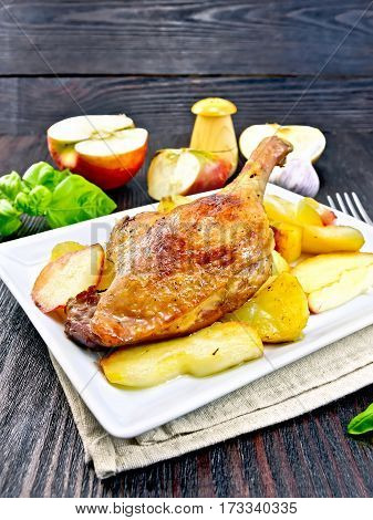 Duck Leg With Apple And Basil In Plate On Napkin