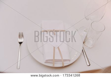 Decorated with bow and lable napkin on setting, served table